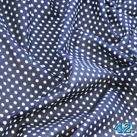 Pamutvászon mintás pöttyös voil anyag, (sötétkék alapon fehér borsószem nagyságú pöttyök), 100%pamut szélesség:150cm